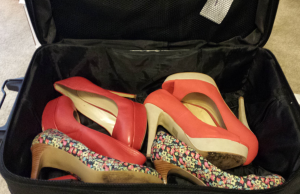 Pictured: 3 of my favorite heels inside of one of my smaller suitcases.